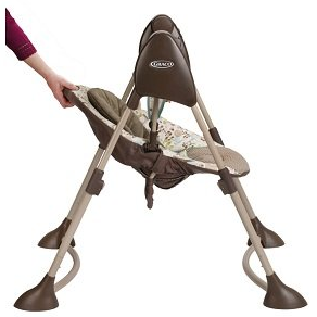 using one hand to recline the seat for Graco Swing  By Me portable swing